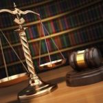 37207795 - justice concept. gavel,  golden scales and books in the library with dof effect.  3d
